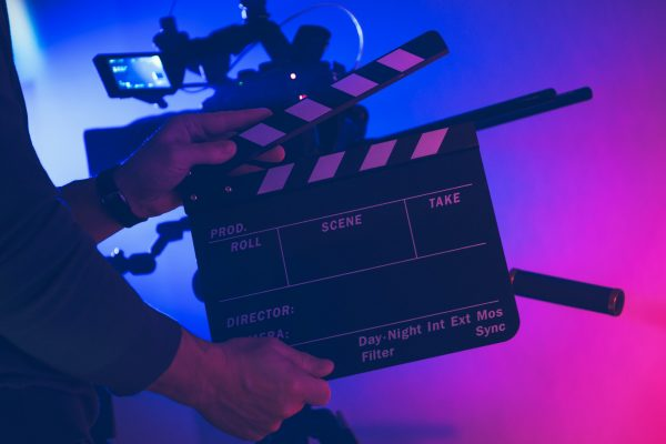 Film Making Professional with Clapperboard in His Hands
